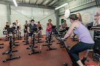 Photo of a spin class with smiling participants