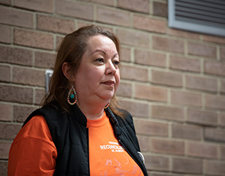 A volunteer wearing an orange shirt