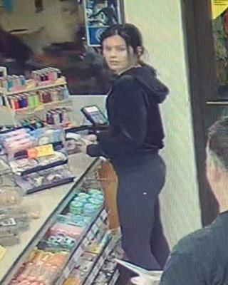 Credit card theft female suspect using credit card