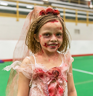 Child dressed up as zombie bride