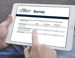 Person completing survey on tablet