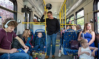 many people enjoying ride on a transit bus